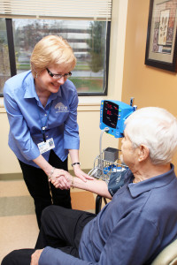 A LIFE St. Mary nurse works with a patient